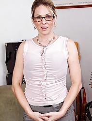 Sexy MILF Angela Attison strips naked mesh work.