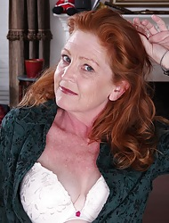 Doyen redhead Veronica Smith strips naked on the desk.